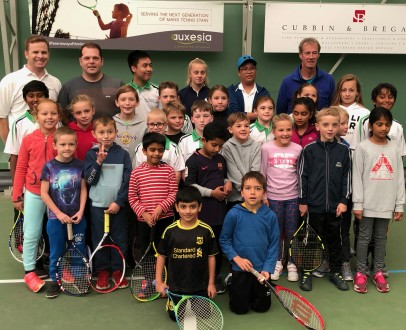 Stuart Colligon with children from the Minis programme at Albany Tennis Club